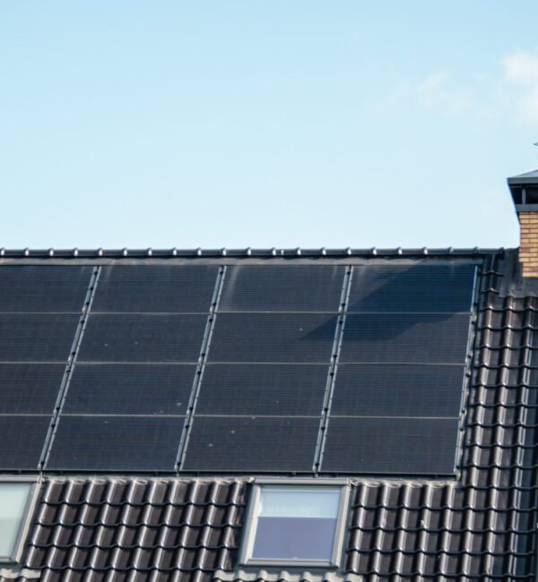 Newly build houses in the Netherlands with solar panels attached on the roof against a sunny sky ,black solar panels Netherlands